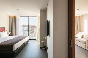 A bed or beds in a room at Porto City House
