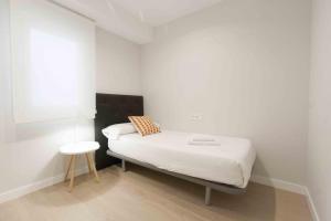 Cama o camas de una habitación en The Rentals Collection | Verona