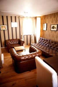 A seating area at Deluxe Apartment -NEW ENGLAND-