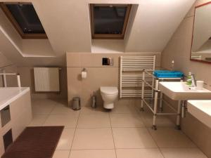 Koupelna v ubytování Apartments Topolova