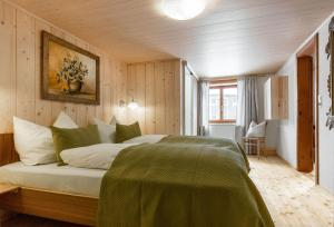 A bed or beds in a room at Haus Ganahl Klostertal