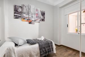 A bed or beds in a room at La casa de los espejos