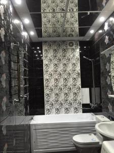 Ванная комната в Апартаменты на Владикавказской