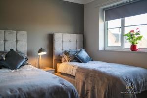 A bed or beds in a room at The Buddha House Huntingdon Boutique Rooms
