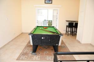 A pool table at Villa Daryah Sirina Bay