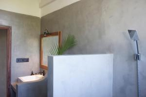 A bathroom at Serene Villa