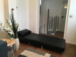 Zona de estar de Maison agréable indépendante à la porte de Paris