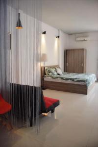 Кровать или кровати в номере Mon house 3 - 169/6A Vo Thi Sau Stress, D.3, HCMC