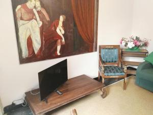 A television and/or entertainment center at Genova Apartments
