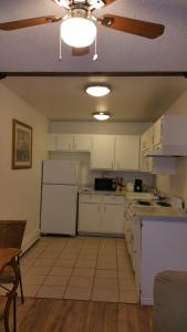 A kitchen or kitchenette at Palace de Reyes Condo