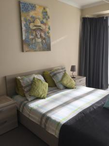 Een bed of bedden in een kamer bij Residentie Royal Park