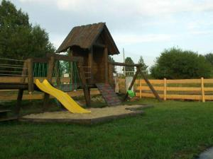 Children's play area at Domki Pasja II