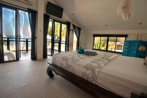 A bed or beds in a room at Malee Beach Villas