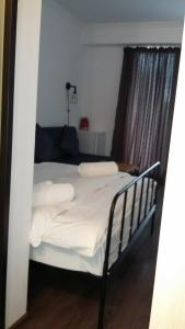 A bed or beds in a room at Gudauri Loft Apartment #401