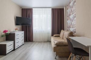 Телевизор и/или развлекательный центр в Apartament on Tereshkovoy 38