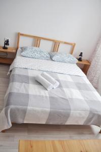 Кровать или кровати в номере Апарт-отель Полёт 4