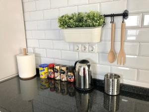 Una cocina o zona de cocina en Audra's Apartment- Wssell de Guimbarda