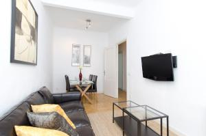 A television and/or entertainment center at Friendly Rentals Arguelles