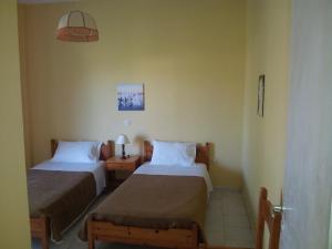Krevet ili kreveti u jedinici u okviru objekta Beach Front Salvanos