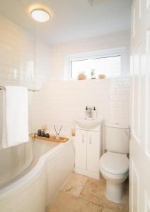 Ein Badezimmer in der Unterkunft Eldertree Garden Holiday Home