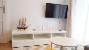 A television and/or entertainment center at Akwamaryn apartment