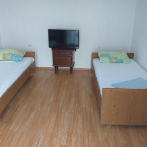 A bed or beds in a room at Apartment Sunrise