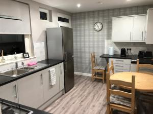 A kitchen or kitchenette at Old Police House Causewayhead
