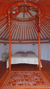 Un ou plusieurs lits dans un hébergement de l'établissement Yourte Nature / Gîte Saint Roch