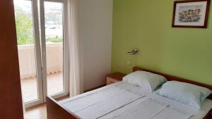 Posteľ alebo postele v izbe v ubytovaní Apartments Anđelina