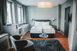 A bed or beds in a room at KH Apartments Center