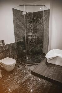A bathroom at KH Apartments Center