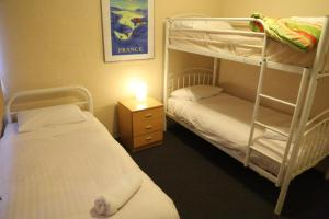 A bunk bed or bunk beds in a room at Kirwan Apartments 49