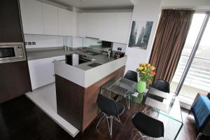 A kitchen or kitchenette at Executive Stay Docklands