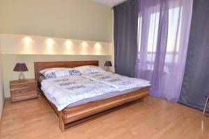 A bed or beds in a room at Apartment at Austria Center and Vienna International Center