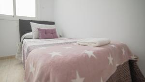 A bed or beds in a room at AR Home - New Lovely 3 bedroom apartment in Telde