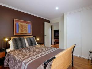 A bed or beds in a room at Straddie Beach House 2