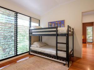 A bunk bed or bunk beds in a room at Straddie Beach House 2