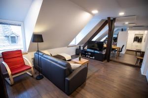 Ein Sitzbereich in der Unterkunft Apartment Duplex in Old Town