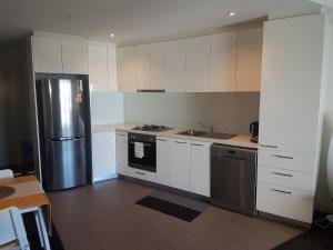 A kitchen or kitchenette at Southbank Short Stay Apartment