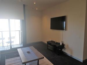 A television and/or entertainment center at Southbank Short Stay Apartment