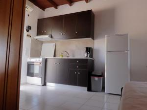 Kjøkken eller kjøkkenkrok på Ledakis Studios