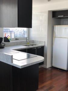 A kitchen or kitchenette at Buenos Aires unique gem, amazing view, parking, amenities and location