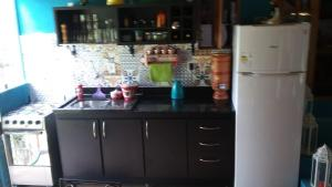 A kitchen or kitchenette at Sitio Vale das Flores