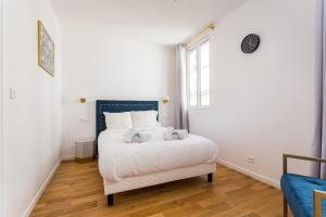 A bed or beds in a room at CMG Montorgueil / Jeuneurs II