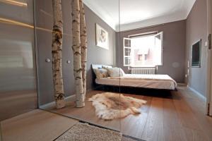 Postelja oz. postelje v sobi nastanitve Stari Trg Apartment