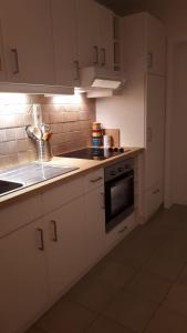 A kitchen or kitchenette at La Merveilleuse