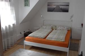 Ein Bett oder Betten in einem Zimmer der Unterkunft Panorama-Rheinblick St. Goar