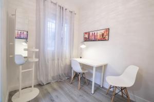 TV a/nebo společenská místnost v ubytování Apartamento cerca de la estación de Atocha