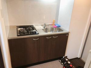 Kuchyň nebo kuchyňský kout v ubytování Stay inn Kyoto Shijo Omiya
