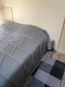 A bed or beds in a room at Gîte à Ugine entre Albertville et Annecy